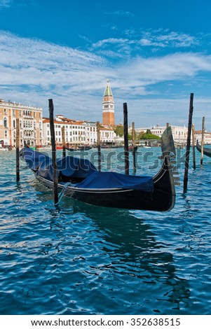 Covered gondola moored on the Grand Canal, Venice, Italy for traditional romantic tours of the canals of this ancient city and its lagoon - stock photo