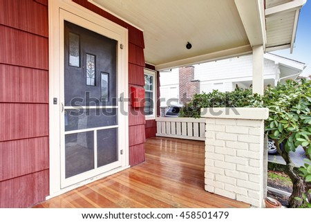 Covered porch with hardwood floor of craftsman old American house. Northwest, USA