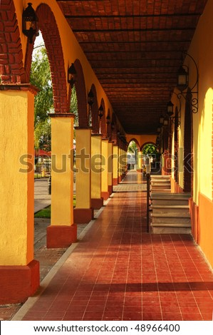 Covered sidewalk in Tlaquepaque shopping district in Guadalajara, Jalisco, Mexico - stock photo