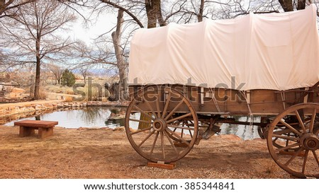 Covered wagon sits next to collected natural spring water at Pipe Spring National Monument