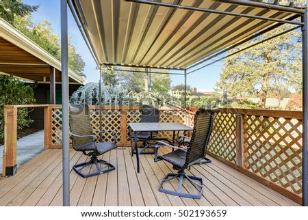 Covered Wooden Deck With Patio Table Set. Summer Time. Northwest, USA