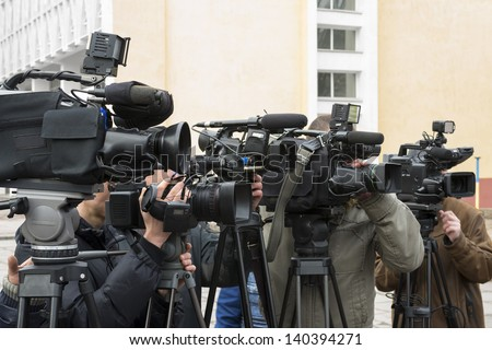 Covering an event with a video camera. - stock photo