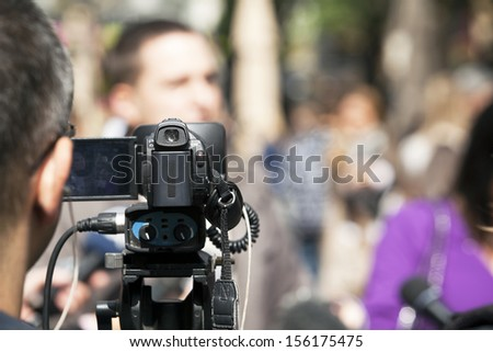 Covering an event with a video camera - stock photo