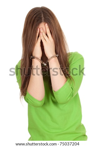 covering face young woman with handcuffed hands - stock photo