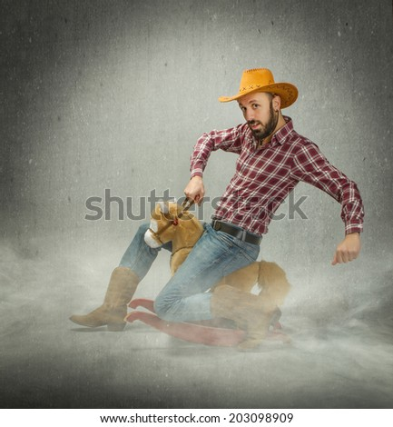 cow boy in a horse rodeo - stock photo