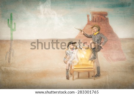 cow boy shooting in a western situation, painted background - stock photo