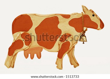 Cow made of wood against white background.