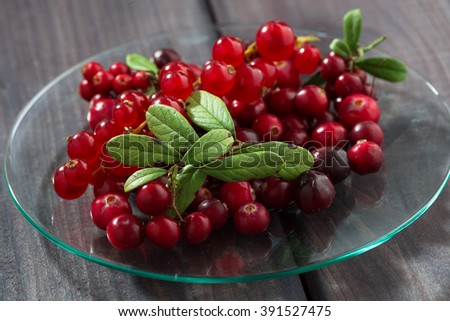 cowberries and red currants in a glass plate, closeup, horizontal - stock photo
