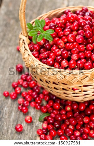 cowberries in a basket on wooden surface