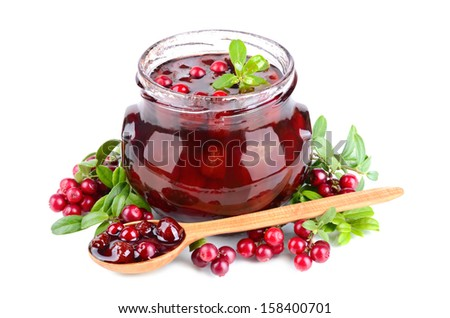 Cowberry or foxberry jam, small spoon and fresh berrys on white background - stock photo