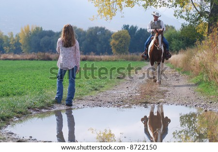 Cowboy and cowgirl - stock photo