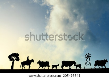 Cowboy background in sunset silhouette - stock photo