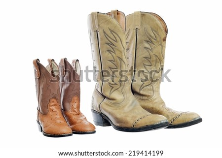 Cowboy boot and Children's boot isolated on white background