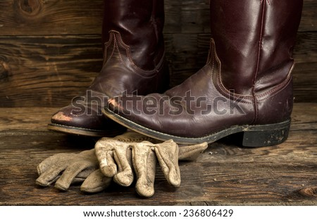 Cowboy boots and leather gloves.