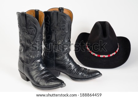 Cowboy Boots with Cowboy Hat - stock photo