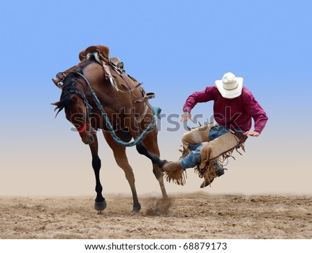 Cowboy bucked of a bucking Bronco isolated with path - stock photo