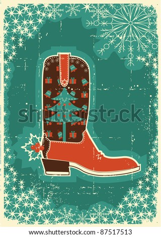 Cowboy christmas  card with boot and holiday decoration on old paper texture - stock photo