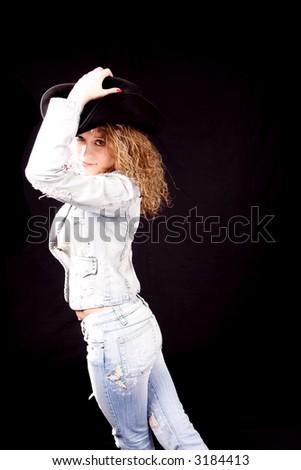 Cowboy girl. Shot in studio. - stock photo