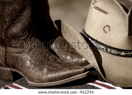 Cowboy hat and boots - stock photo
