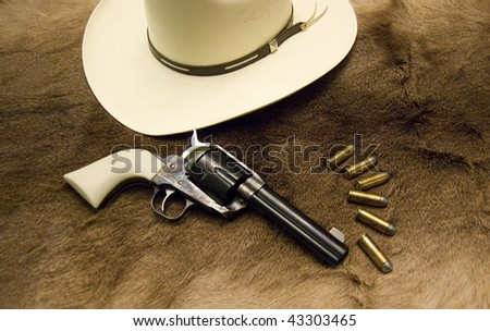 Cowboy hat and gun - stock photo