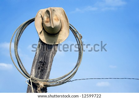 Cowboy Hat and Lasso - stock photo