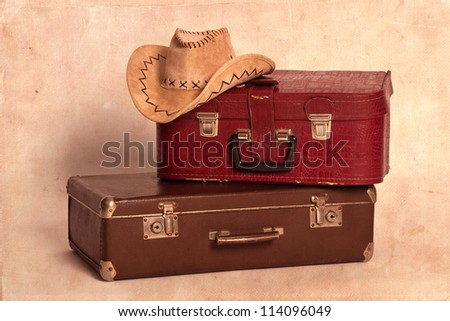 Cowboy hat and suitcases - stock photo