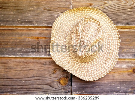 Cowboy hat on the wood wall,this image adjust color to dark tone color. - stock photo