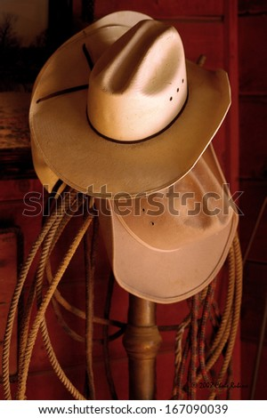 Cowboy Hats Hanging on a rack - stock photo