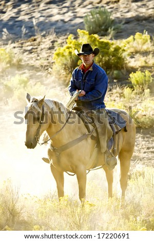 Cowboy in Early Morning Light - stock photo