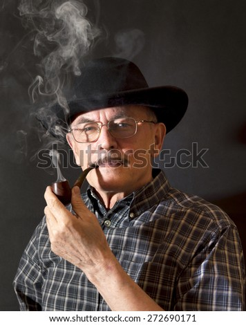 Cowboy in hat with Pipe