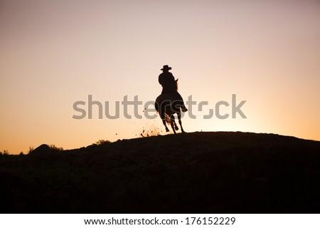 Cowboy in North Dakota, Sunset ride - stock photo