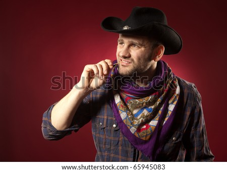 cowboy in red background