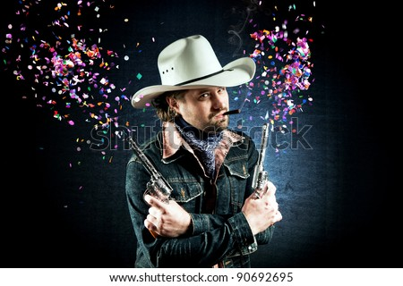 Cowboy in white hat shooting confetti out of two toy guns - stock photo
