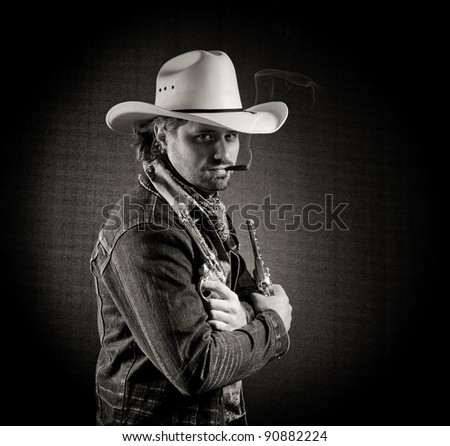 Cowboy in white hat with two toy guns and cigar