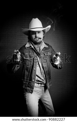 Cowboy in white hat with two toy guns and cigar - stock photo