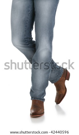 Cowboy Legs in Jeans and Boots - stock photo