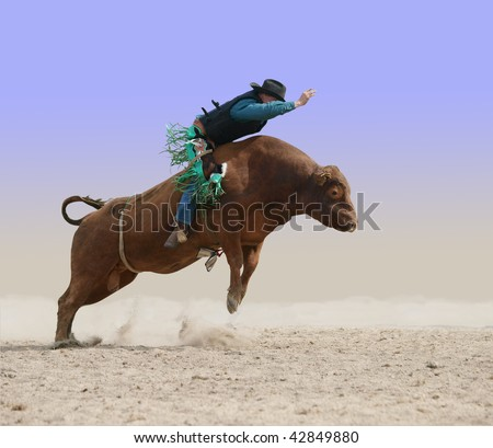 Cowboy on a Red Bull isolated with clipping path - stock photo