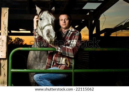 Cowboy portrait with horse - stock photo