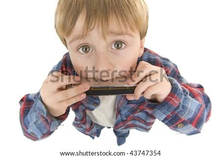 cowboy Preschooler plays the harmonica - stock photo