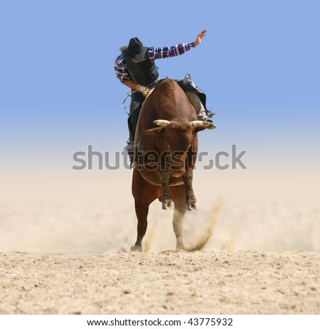 Cowboy Riding a Large Red Bull isolated with clipping path - stock photo