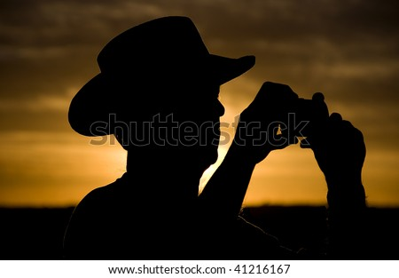 Cowboy silhouette at sunset in Grand Canyon