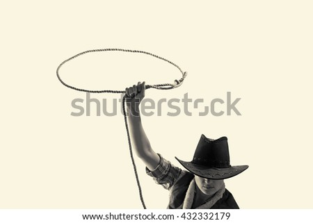 cowboy throws a lasso on the isolated background - stock photo