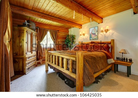 Cowboy western bedroom interior with wood ceiling. - stock photo