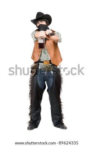 Cowboy with a gun and bottle of whiskey in hands - stock photo