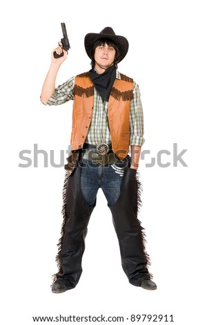 Cowboy with a gun in hand. Isolated - stock photo
