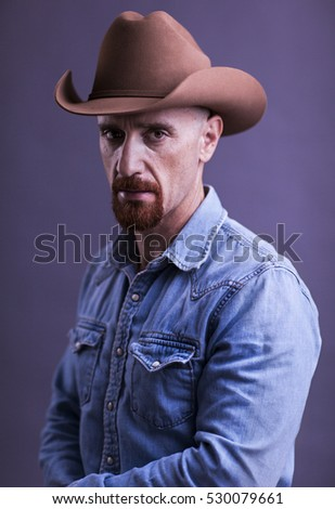 Cowboy with Red Goatee in Blue denim chambray shirt and Stetson Cowboy hat