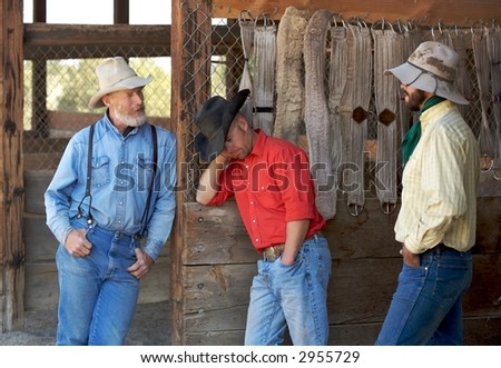 cowboys taking a break to stand and chat
