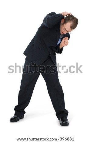Cowering Business Man In Suit. Facing forward. - stock photo