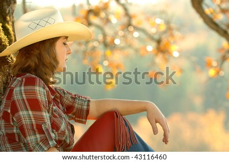 cowgirl and jeans - stock photo