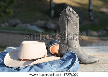 Cowgirl hat, boots and jacket - stock photo